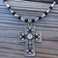 Handmade beaded cross necklace with bullet casing