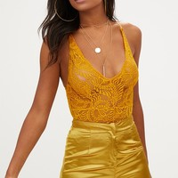 Mustard Sheer Lace Cross Back Bodysuit