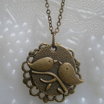 Bird necklace- Filigree necklace- Two birds on a branch-  Spring Accessory- Antique brass necklace- Nature- Bird- Flower- Leaf