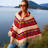 Vintage 1970s Rainbow Hippie Native Thick Wool Poncho Hand knit Fringe Shawl Tribal Navajo Crochet Bright Colors