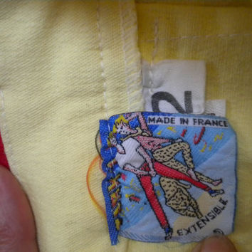FRENCH Vintage skirt, made in France, mini skirt with Minnie Mouse motif, stretchy fabric, light yellow.