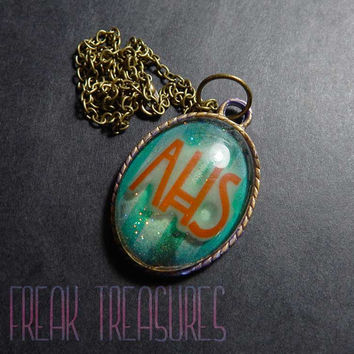 Glow in the dark horror necklace/keyring