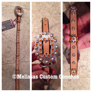 Light oil dog collar. Sun and clear Swarovski crystals. 21 1/2 inches with four 3/4 inch conchos. Clear rivets with a cart buckle.