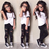 2016 Newest Stylish Kids Baby Girls Clothes Sets 2PCS England Style Letter Tops T shirt Hollow Out Pants Outfits Set Age 2 7Y-in Clothing Sets from Mother & Kids on Aliexpress.com | Alibaba Group