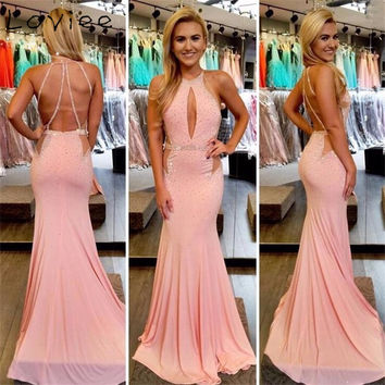 Sexy Nude Pink Mermaid Prom Dresses 2016 Halter Crystal Sequined Criss Cross Back Girls Graduation Party Gowns Vestido De Festa