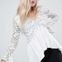 Boohoo Lace Cut Out Peplum Top at asos.com