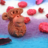 Small funny souvenir collectible ceramic animal figurine of smiling monkey