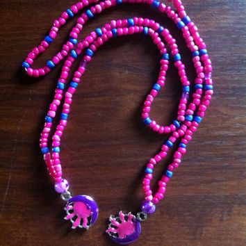 Sun and moon face pink stretch necklace