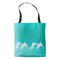 Dolphins in aquamarine turquoise colored ocean tote bag