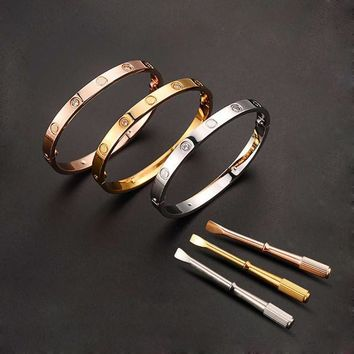One-nice? Stainless Steel Cartier Style locking bracelet with key