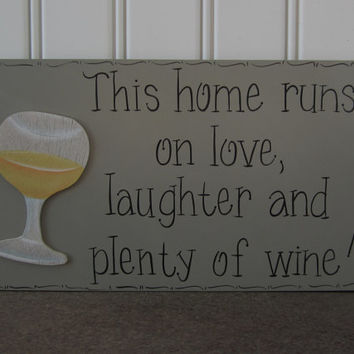 "Hand Painted Wooden Gray Funny Wine Sign, ""This home runs on love, laughter and plenty of wine."""