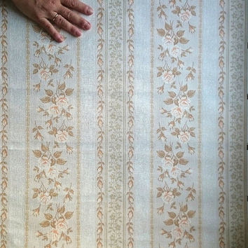 Four rolls of retro vintage Soviet era wallpaper from the 1970s with creamy and rosy rose patterns