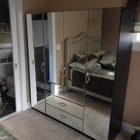 Mirrored armoire closet in customer's home