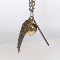 "Harry Potter book/movie series antique gold and brass tones necklace ""Golden Snitch"" from the game Quidditch -Bronze Tone Golden Snitch Harry Potter The Deathly Hallows"