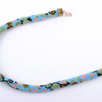 Handmade Czech bead cord necklace of turquoise color with unusual patterns
