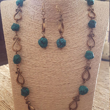 Handmade turquoise stones necklace with rusty vintage charms and earrings.