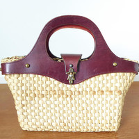 Preppy Etienne Aigner leather and straw top handle handbag