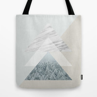 Snow into the forest Tote Bag by Cafelab
