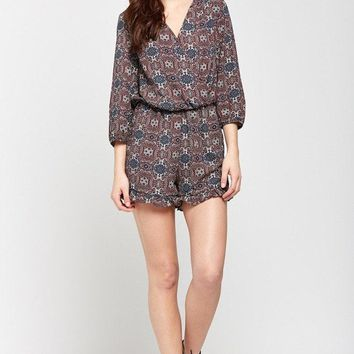 Exotic Escape Deep-V Ruffled Hem Romper