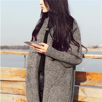 Autumn and winter new large sweater coat long paragraph women knitted loose pure color cardigan