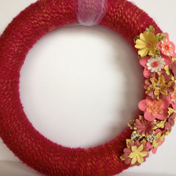 Pink yarn wreath with pink and yellow flowers