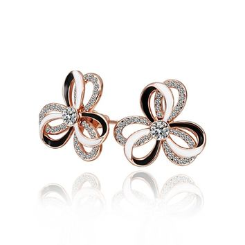 Rose Gold Plated Brass Triple Layered Rose Petals Stud Cubic Zircon Earrings | Overstock.com Shopping - The Best Deals on Cubic Zirconia Earrings