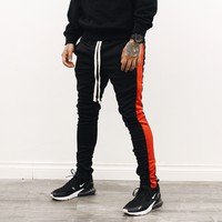 Amari Track Pants (Black/Red)