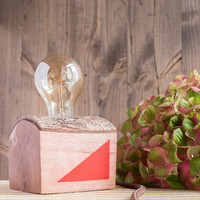 Small wood lamp with red triangles and tree bark
