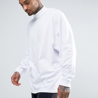 ASOS Longline Long Sleeve T-Shirt With Batwing Oversized Sleeve In White at asos.com