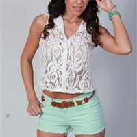 Sleeveless white lace button up