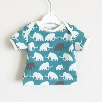 Baby lap neck shirt with mammoths. Toddler t-shirt. Kid's top. Green shirt with white and grey mammoths. Cotton knit fabric.
