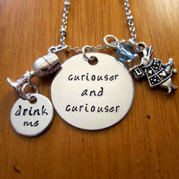 "Disney's ""Alice in Wonderland"" Inspired Necklace. ""Curiouser and curiouser"". Drink me. Silver colored. Swarovski crystals."