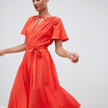 River Island midi dress with tie neck and waist detail in red at asos.com