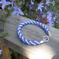 Delightful Purple and White Beaded Bracelet