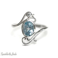 Sterling Silver Oval Blue and White Topaz Filigree Ring