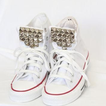 silver studded white high top converse