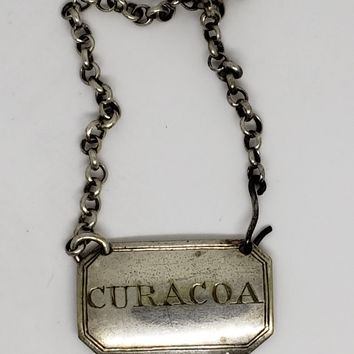 Curacao Silver Plate Decanter Tag
