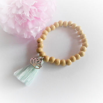 Elastic Bracelet With Mint Tassel And Lotus Flower Charm