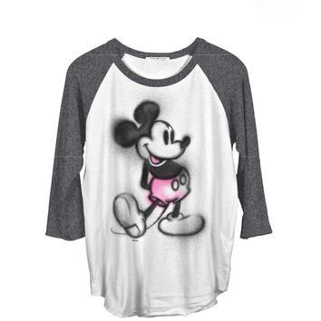 Junk Food Clothing x Disney Collection Mickey Mouse super soft Raglan tee. Mickey Mouse silhouette graphic screened on front, 3/4 Sleeve, raw edge asymmetrical hemline . Contrast black wash 3/4 sleeves, scoop neckline and finish with pigment dyed & destroy