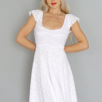 Imogen: White lace short reception dress with circle skirt & cap sleeves