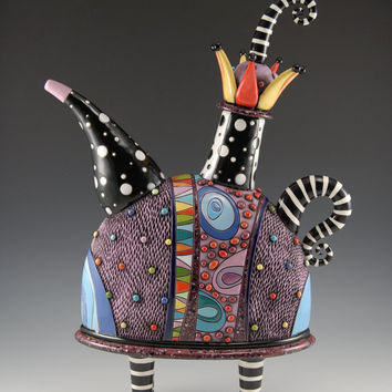 Whimsical Purple Teapot with Striped Legs