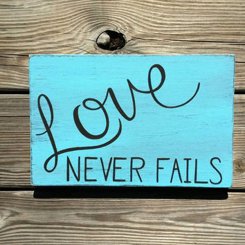 Love Never Fails Distressed Blue, Brown Wooden Reclaimed Wood Hand Painted Sign