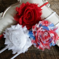 Set of three shabby chic 4th of July headbands on 1/8 elastic and backed with soft felt for added comfort. Your Final Touch to your patriotic outfit.
