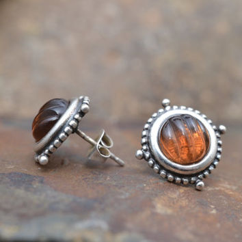 Sterling Silver Stud Earrings with Carved Amber Colored Stone