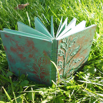 Handpainted and patinated sketchbook with green pastel paper inside