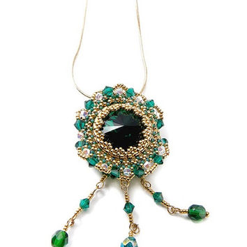 Brooch, pendant with Swarovski emerald - colour crystal, gold seed beeds. stylish jewelry.Beadwork