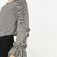 CHECKED TOP WITH FRILLED SLEEVES