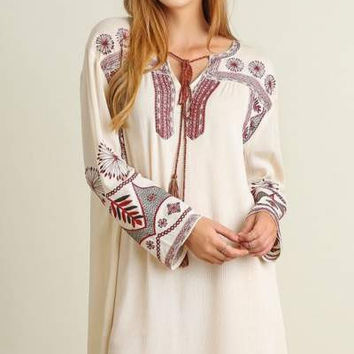 Umgee Long sleeve dress with embroidery details and tassel tie neckline