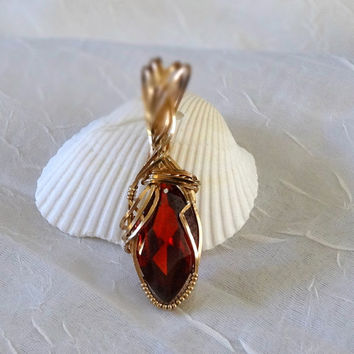 Free Form Wire Wrapped Garnet  Pendant Set In 14 K Gold Filled Wire