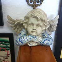 Tattooed ceramic baby angel